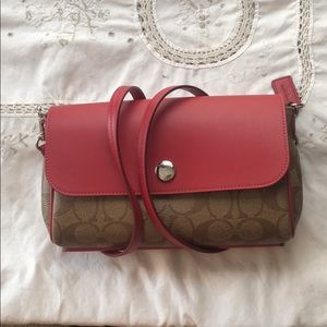 Reversible coach crossbody clutch